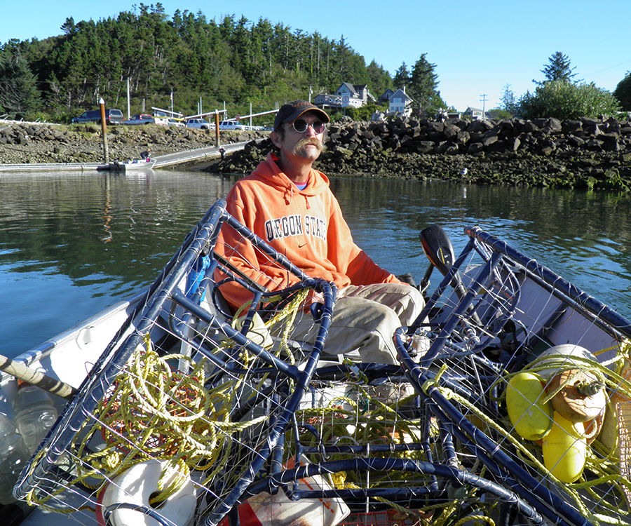 David D. Hunter, certified arborist, sitting in boat with fishing gear