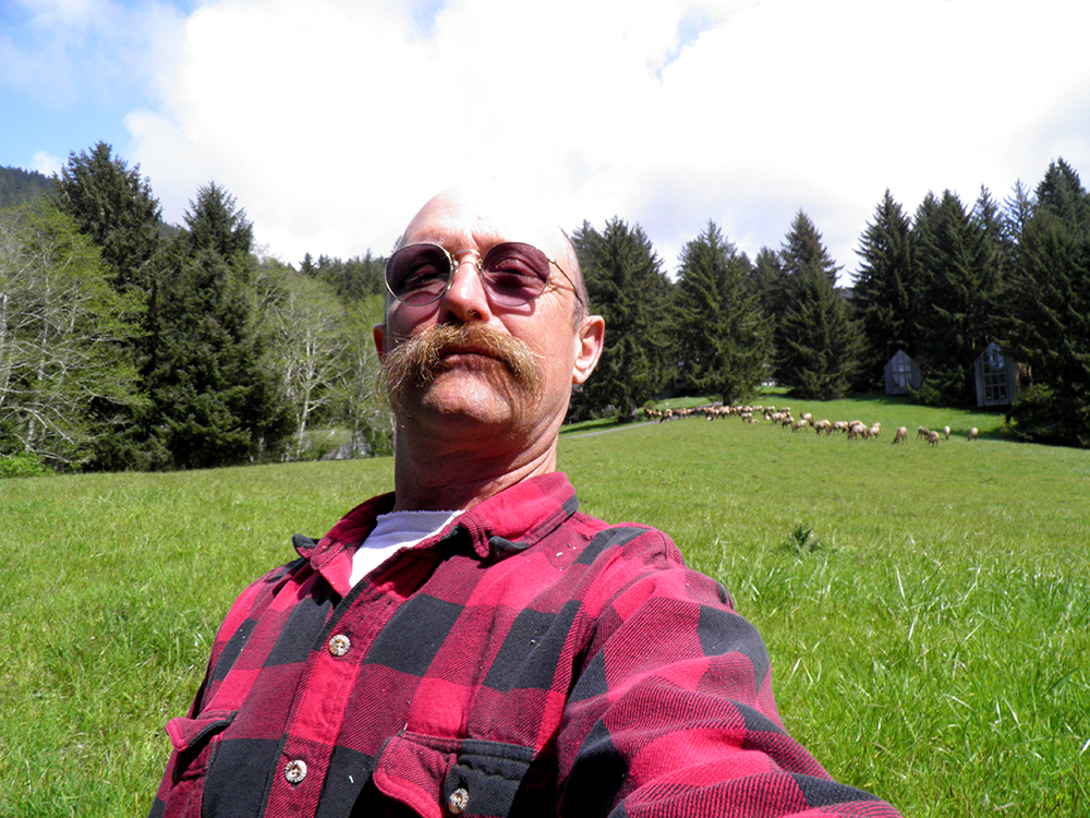 david d. hunter, certified arborist in front of field with